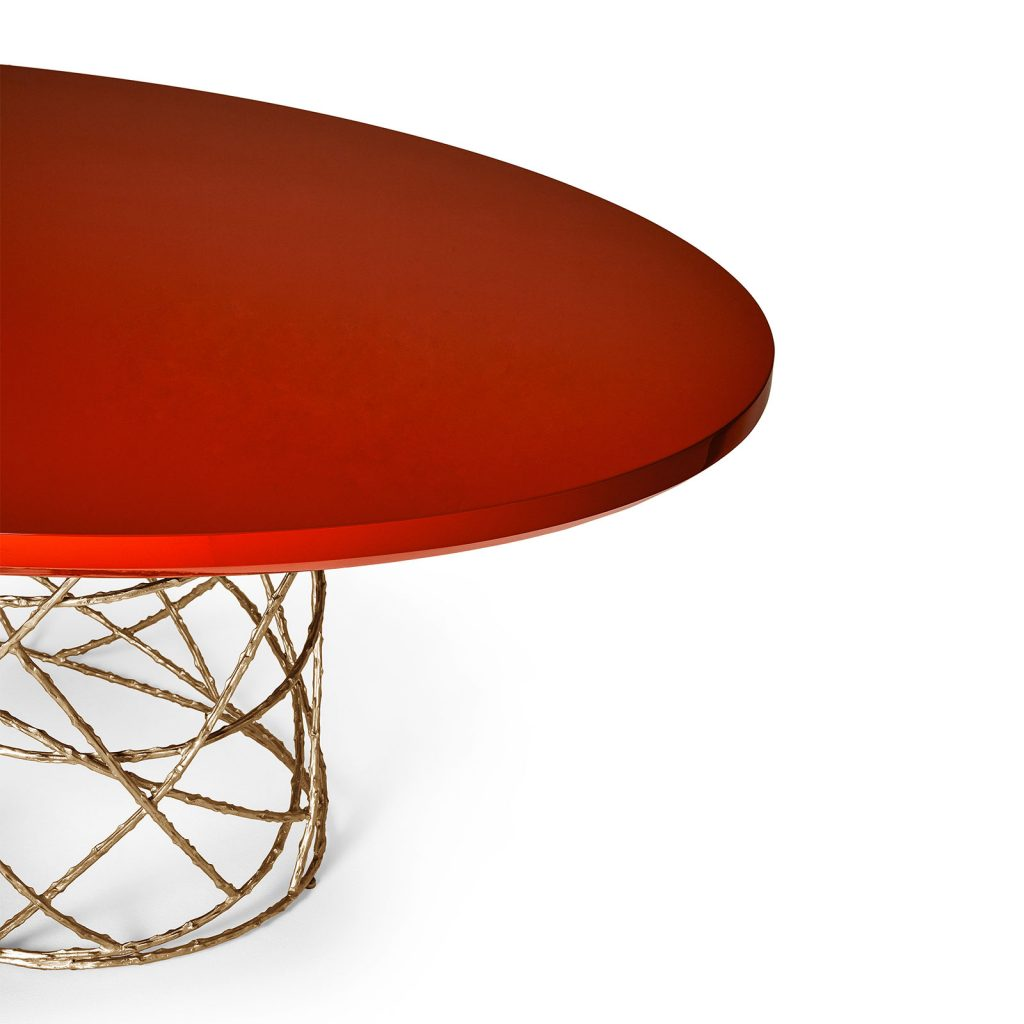 Rosebush Oval Dining Table with a lacquered top.